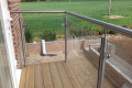 A bespoke railing overlooking a green field