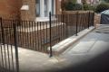 A metal railing guarding a steep drop